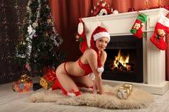 Beautiful woman near the fireplace in winter house. selebrating christmas Stock Photography
