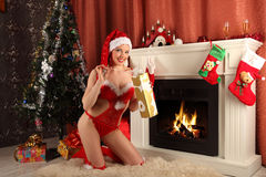 Beautiful woman near the fireplace in winter house. selebrating christmas Royalty Free Stock Images