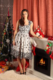 Beautiful woman near the fireplace in winter house Royalty Free Stock Photos