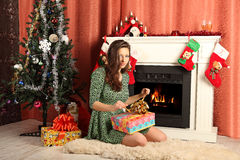 Beautiful woman near the fireplace in winter house Royalty Free Stock Photo