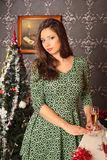 Beautiful woman near the fireplace in winter house Stock Photo