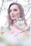 Beautiful woman - near the flowering trees Stock Images