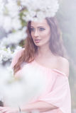 Beautiful woman - near the flowering trees Royalty Free Stock Photo