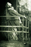 The beautiful woman near a handrail Stock Photography