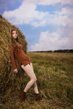 Beautiful woman near a haystack Royalty Free Stock Photography