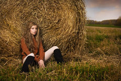 Beautiful woman near a haystack Royalty Free Stock Photos