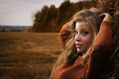 Beautiful woman near a haystack Royalty Free Stock Image