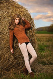 Beautiful woman near a haystack Royalty Free Stock Images