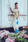 Beautiful woman near luxury building facade Stock Photography