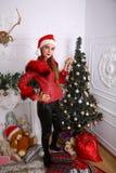 Woman near x-mas tree. Beautiful woman near x-mas tree, happy New Year party Royalty Free Stock Photography
