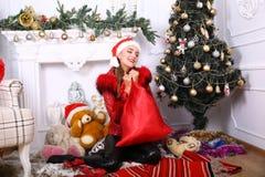 Woman near x-mas tree. Beautiful woman near x-mas tree, happy New Year party Royalty Free Stock Image