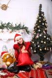 Woman near x-mas tree. Beautiful woman near x-mas tree, happy New Year party Royalty Free Stock Photo