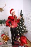 Woman near x-mas tree. Beautiful woman near x-mas tree, happy New Year party Stock Images