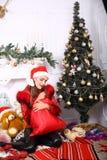 Woman near x-mas tree. Beautiful woman near x-mas tree, happy New Year party Stock Photo