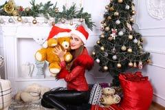Woman near x-mas tree. Beautiful woman near x-mas tree, happy New Year party Stock Photos