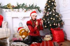 Woman near x-mas tree. Beautiful woman near x-mas tree, happy New Year party Royalty Free Stock Photos