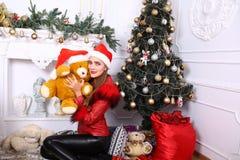 Woman near x-mas tree. Beautiful woman near x-mas tree, happy New Year party Stock Image