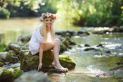 Beautiful woman near a mountain river Stock Photography