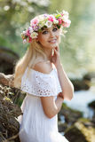 Beautiful woman near a mountain river Stock Images