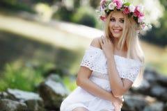 Beautiful woman near a mountain river Stock Photos