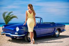 Beautiful woman near retro cabriolet car Royalty Free Stock Image
