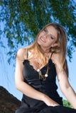Beautiful woman near the river Stock Photo