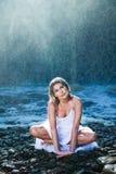 Beautiful woman near river waterfalls Royalty Free Stock Photos