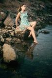 Beautiful woman near the sea stock images