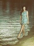 Beautiful woman near the sea stock photo