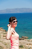 Beautiful woman near the sea during summer vacation Stock Photos