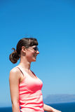 Beautiful woman near the sea during summer vacation Stock Images
