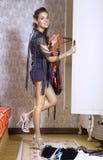 Beautiful woman near wardrobe Stock Photos