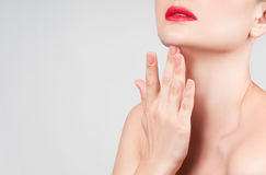 Beautiful woman neck with clean skin and red lips Stock Images