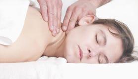 Beautiful woman neck massage spa. Young beautiful young woman receiving back massage at spa Stock Photography