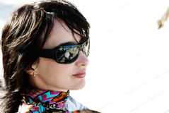 Beautiful woman in neckerchief. And sunglasses relaxing under the sun Stock Photo