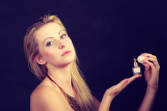 Beautiful woman with necklace holding perfume Royalty Free Stock Photos
