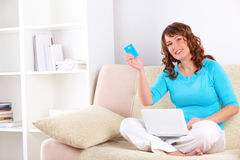 Beautiful woman with netbook and credit card Stock Images