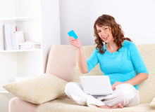 Beautiful woman with netbook and credit card Stock Photos