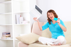 Beautiful woman with netbook and credit card Stock Image