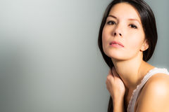 Beautiful woman with a neutral expression Stock Photo