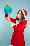 Beautiful woman in new year costume with  a globe Stock Photography
