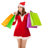 Beautiful woman in new year costume with shopping bags Royalty Free Stock Image