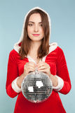Beautiful woman in new year costume with a silver ball Royalty Free Stock Images