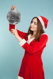 Beautiful woman in new year costume with  a silver ball Royalty Free Stock Image