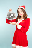 Beautiful woman in new year costume with  a silver ball Stock Photos
