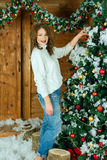 Beautiful woman in new year interior dresses Royalty Free Stock Photo