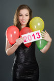 Beautiful woman at new years eve. With card 2013 Stock Photo