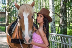 Beautiful woman next to a horse on nature Royalty Free Stock Images