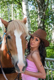 beautiful woman next to a horse on nature Stock Photos