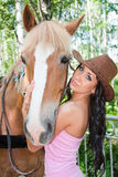 Beautiful woman next to a horse on nature Royalty Free Stock Photo